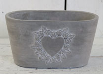 Small Cement Trough with Heart Decoration Formed by Tiny Roses