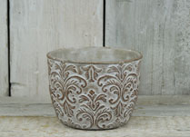 Round planter with damask-style pattern