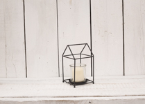 Gorgeous black house shape lantern with glass insert. Perfect for a gift or as a decoration in your home!
