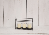 Gorgeous black house shape tealight. Perfect for a gift or as a decoration in your home!