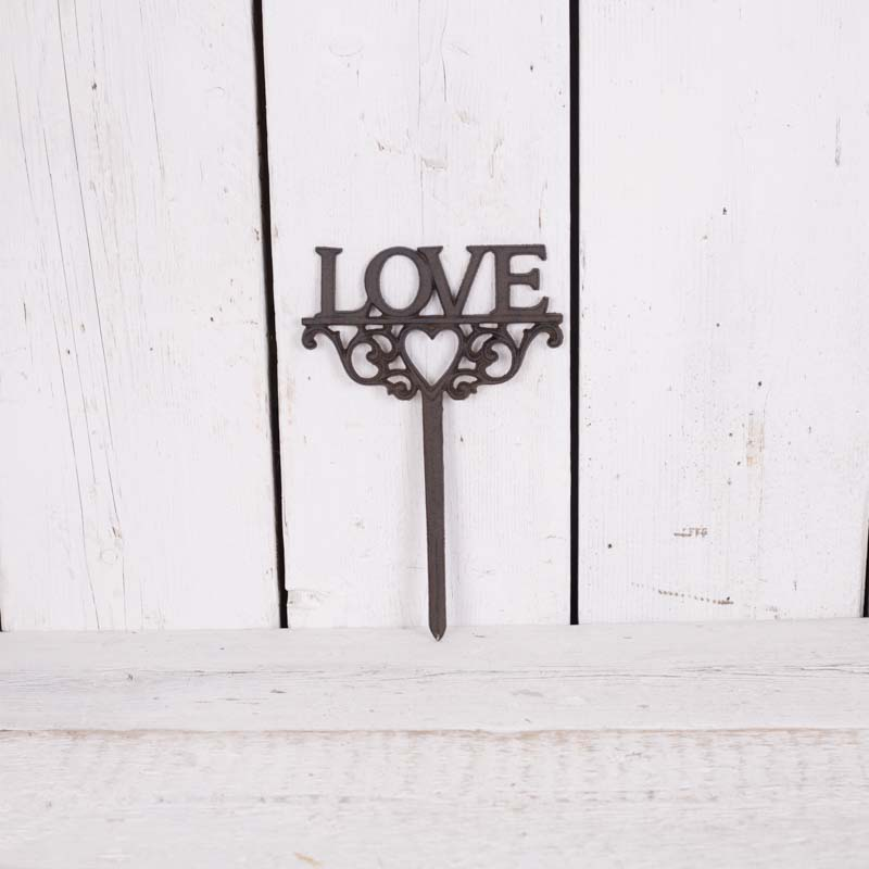 Lovely cast iron garden pick. Great garden accessory!