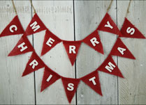 Red Hessian Christmas Bunting with MERRY CHRISTMAS written on the flags