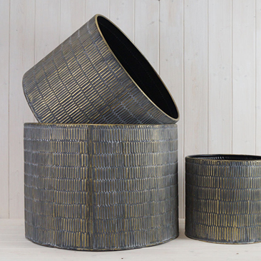 Set of 3 round metal planters with gold embossed detail.
