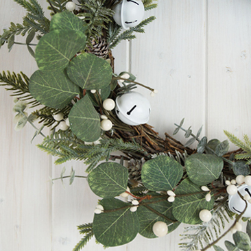 Close-up of winter wreath with white berries and eucalyptus.