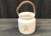 Ceramic tealight with star pattern cut out