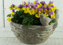 Eye-catching stone nest planter with perching birds