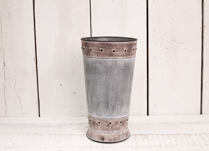 Lovely embossed zinc vase. Perfect for putting your fresh flowers in!