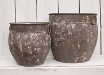 Gorgeous set of two rustic urns with ring handles. Would look lovely with some fresh flowers!