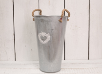 Gorgeous zinc vase with white heart design. Perfect home accessory this Spring!
