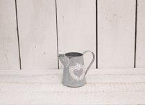 Lovely whitewash zinc jug with heart flowers design. This would look perfect with some fresh flowers!