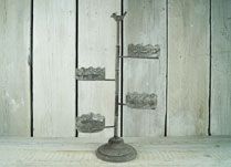 Whitewashed metal floristry cake stand with filligree edging