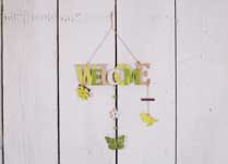 Green, yellow and white detailed hanging Welcome Sign with butterfly and flower accessories