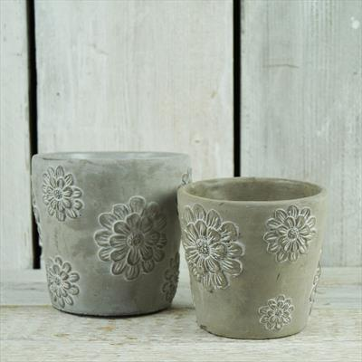 Stone pots with floral pattern