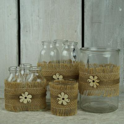 Glass jars and bottles decorated with hessian ribbon