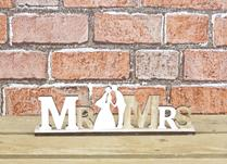 Wooden 'MR & MRS' sign with figures