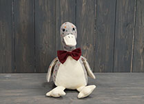 Sitting Up Duck Doorstop with Bow Tie detail page