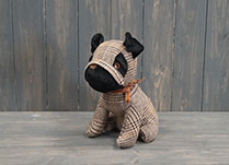 Sitting Pug Dog Doorstop detail page